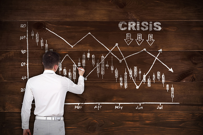 businessman drawin crisis chart on brown wooden wall